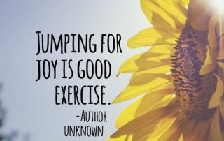 "Side view of sunflower in sunshine with quote ""Jumping for joy is good exercise"" - Author Unknown"
