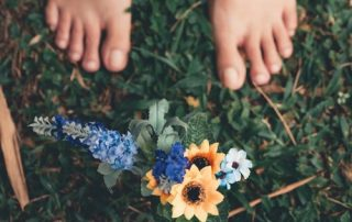 Feet in grass with flowers
