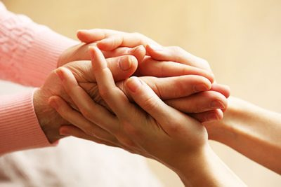 Healthcare Professional Holding Patients Hands in support