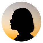 Silhouette of a woman with sunset behind her