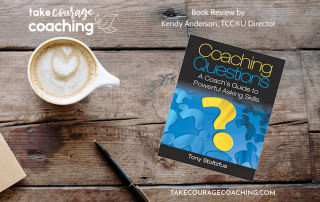 Book cover on desk Coaching Questions by Tony Stoltzfus